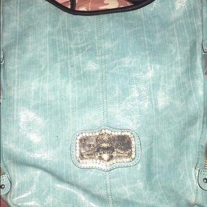 Kathy Van Zeeland teal blue patent leather purse